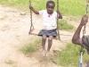 Cute girl on a swing